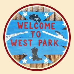 Vítejte ve West Parku, cedule.